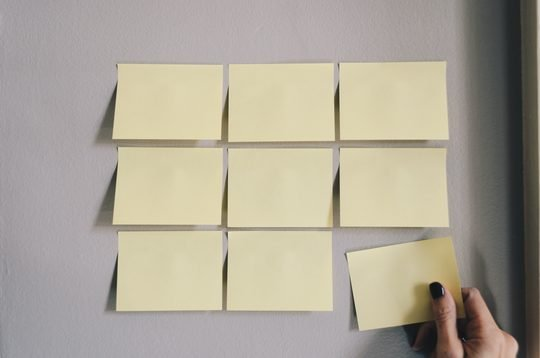 Blank post-its on a wall